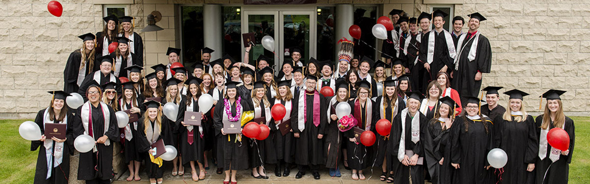 The graduating class of 2015 standing outside of Don Anderson Hall with Dean Abramson