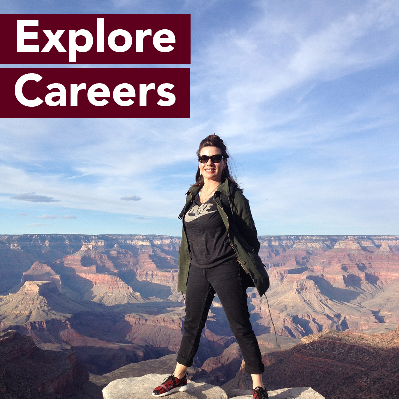 Woman on mountain top in Nike shirt. Explore Careers.