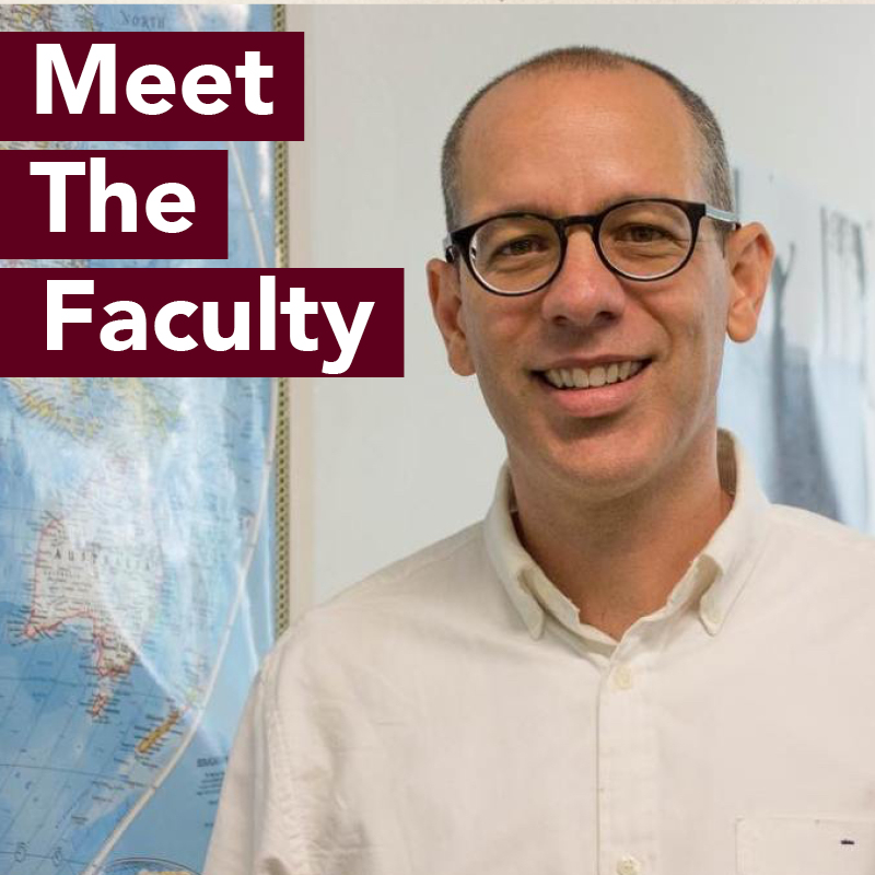 Photo of professor Joe Eaton in front of board. Meet the Faculty